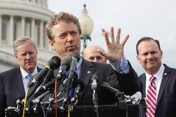 Sen. Rand Paul (R-KY) (C) speaks about Obamacare repeal and replacement while flanked by Sen. Mike Lee (R-UT)(R), and Rep. Mark Meadows (R-NC) (L) and members of the House Freedom Caucus, during a news conference on Capitol Hill, on March 7, 2017 in Washington, DC.
