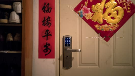 A special lock lets host and guests easily gain access to the home of Sun Huifeng, who rents out one of the rooms, in Beijing, March 11, 2017.