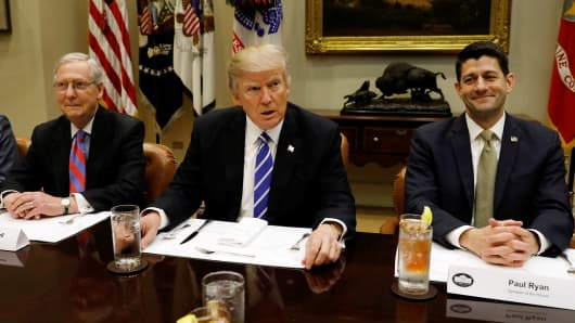 President Donald Trump hosts a lunch with Senate Majority Leader Mitch McConnell (L) and Speaker of the House Paul Ryan (R) at the White House in Washington, U.S. March 1, 2017.