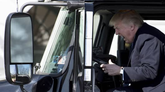 President Donald Trump sits in the drivers seat of a semi-truck as he welcomes truckers and CEOs to the White House in Washington, DC, March 23, 2017, to discuss healthcare.
