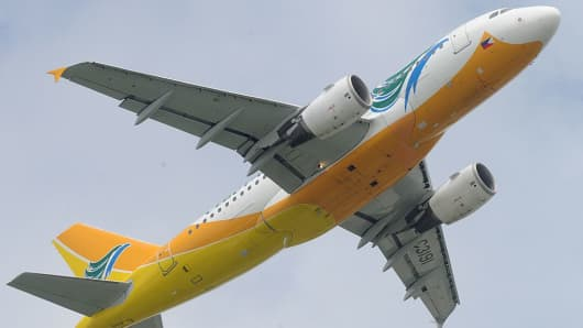 A Cebu Pacific jet takes off from Manila airport.