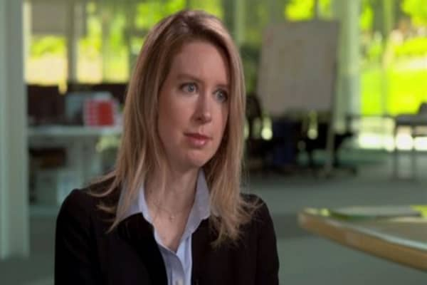 Theranos' found is giving away shares to avoid lawsuits