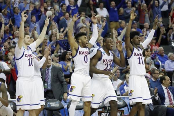 Sviatoslav Mykhailiuk #10, Frank Mason III #0, Dwight Coleby #22 and Josh Jackson #11 of the Kansas Jayhawks celebrate defeating the Purdue Boilermakers 98-66 during the 2017 NCAA Men's Basketball Tournament.