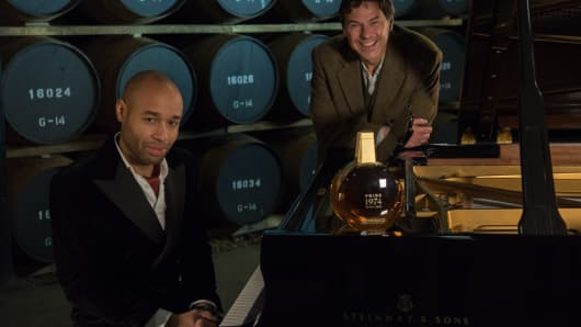 Diehl and Lumsden at the piano, surrounded by casks of whisky and a special bottle of Pride 1974.