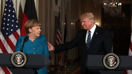 U.S. President Donald Trump (R) holds a joint press conference with German Chancellor Angela Merkel in the East Room of the White House on March 17, 2017.