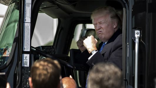President Donald Trump sits in the cab of a tractor trailer during an event with truckers and truck industry chief executive officers on the South Lawn of the White House in Washington, D.C., U.S., on Thursday, March 23, 2017.