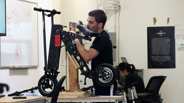 An engineer is adding the final touches to an URB-E in the company's Pasadena factory.