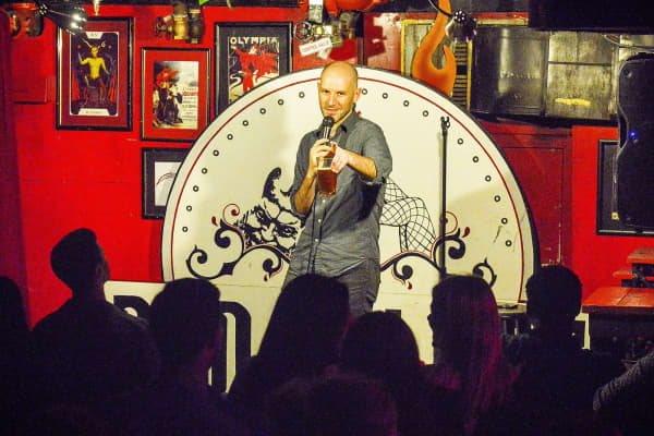 Sean Joyce, a D.C. comedy promoter, warms up a packed house during a recent show at the Big Hunt