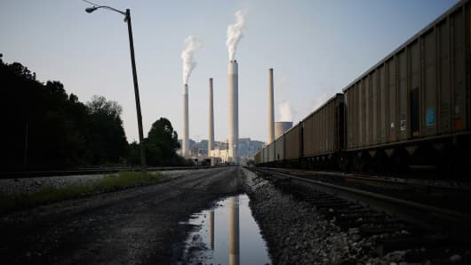 Emissions rise from the American Electric Power Co. Inc. coal-fired John E. Amos Power Plant in Winfield, West Virginia.