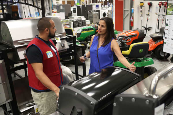 Eddie Zelaya helps Carmen Ledesma as she shops for a BBQ grill at the Lowe's store on March 1, 2017 in Hialeah, Florida.