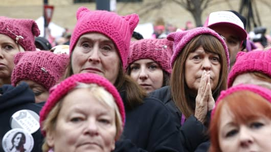 A woman reacts as she listens to a speaker during a rally at the Women's March on Washington, Jan. 21, 2017.