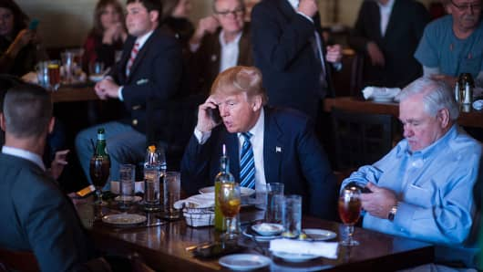 Donald Trump talks talks on the phone during his campaign trail on Thursday Feb. 18, 2016.