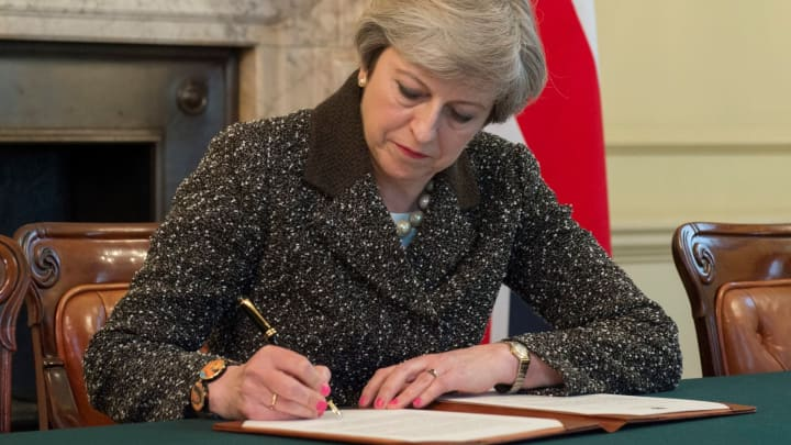 British Prime Minister Theresa May signs the official letter to European Council President Donald Tusk invoking Article 50 and the United Kingdom's intention to leave the EU on March 28, 2017 in London, England.