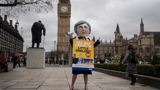 A pro-EU protester dressed as Prime Minister Theresa May takes part in a demonstration near Parliament on March 29, 2017 in London, England.