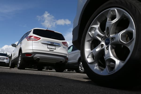 A Ford Escape is seen on a dealerships lot on September 26, 2014 in Miami, Florida.