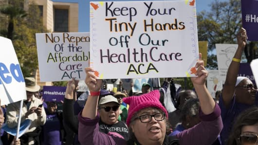 Supporters of the Affordable Care Act participate in a Save Obamacare rally in Los Angeles, California on March 23, 2017.