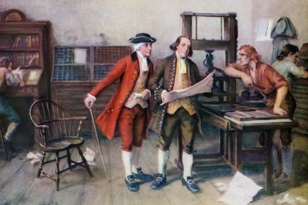 Benjamin Franklin and associates at Franklin's printing press in 1732.