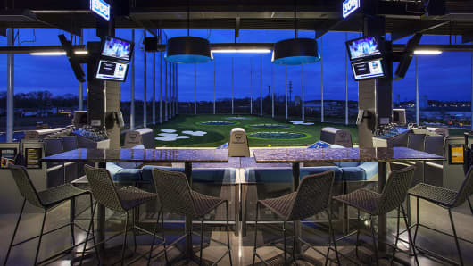 Topgolf combines golf with entertainment.  Patrons can play competitive games while enjoying the atmosphere of a bar or nightclub.