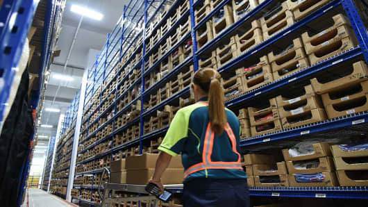 An employee at a SingPost warehouse in Singapore