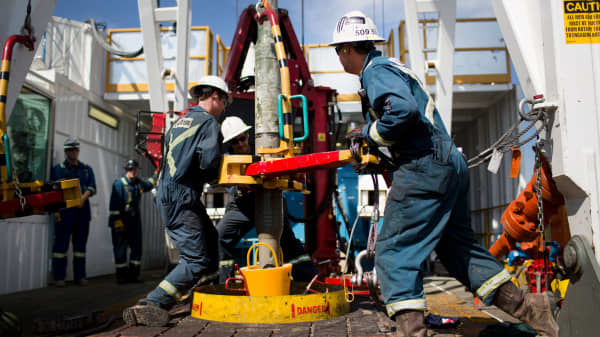 Employees torque a pipe at a wedge well at Christina Lake, a situ oil production facility half owned by Cenovus Energy and ConocoPhillips, in Conklin, Alberta, Canada.