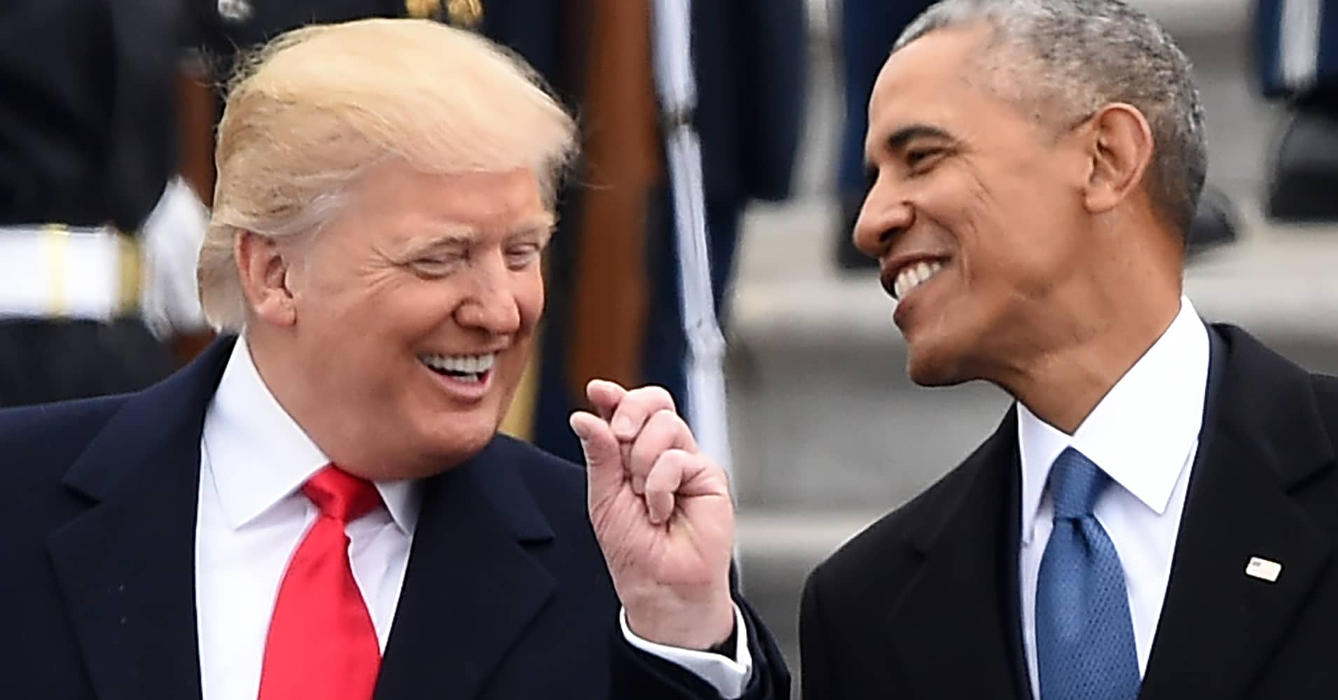 President Donald Trump and former President Barack Obama talk on the East steps of the US Capitol after inauguration ceremonies on January 20, 2017, in Washington, DC.