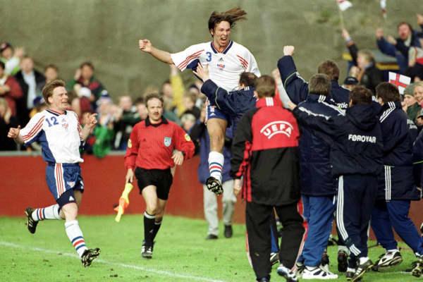 Hans Frooi Hansen celebrates after scoring a goal.