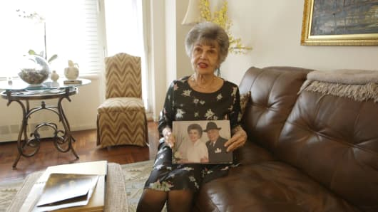 Sandra Baxter displays a picture book of herself and her husband Marvin.