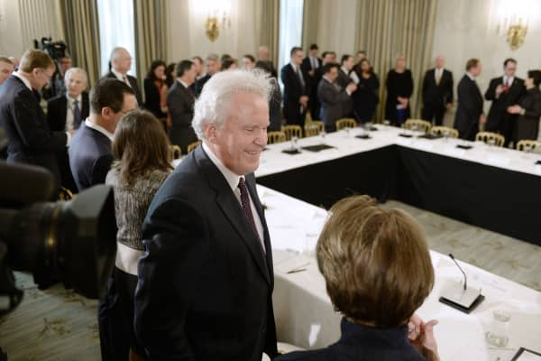 Jeff Immelt, chairman and chief executive officer of General Electric Co, speaks with an attendee during a meeting with U.S. President Donald Trump, not pictured, and manufacturing executives in the State Dining Room of the White House in Washington, D.C., U.S., on Thursday, Feb. 23, 2017.