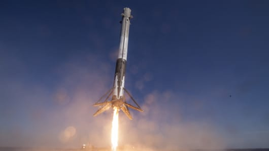 SpaceX's Falcon 9 rocket makes its first successful upright landing on the 'Of Course I Still Love You' droneship on April 8, 2016 some 200 miles off shore in the Atlantic Ocean after launching from Cape Canaveral, Florida.