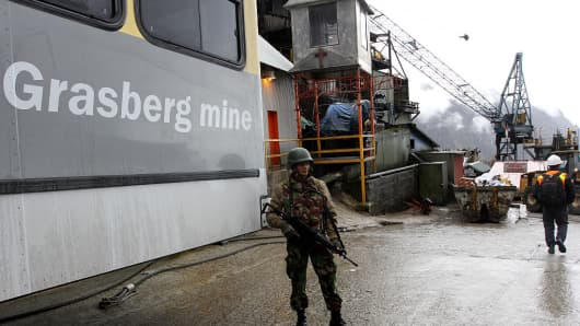 An armed soldier stands guard outside a tram station at Freeport McMoRan's Grasberg copper and gold mining complex in Papua province, Indonesia, on Wednesday, April 22, 2015.