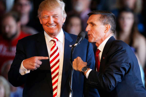 Then-presidential candidate Donald Trump jokes with retired Gen. Michael Flynn as they speak at a rally at Grand Junction Regional Airport on October 18, 2016 in Grand Junction Colorado.