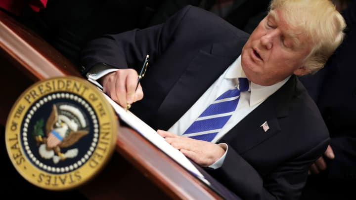 Donald Trump signs an executive order on March 27, 2017.