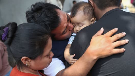 Guatemalan deportee Eric Perez, 23, kisses his daughter Kimberly, 18 months, after he arrived on an ICE deportation flight on February 9, 2017 to Guatemala City, Guatemala.