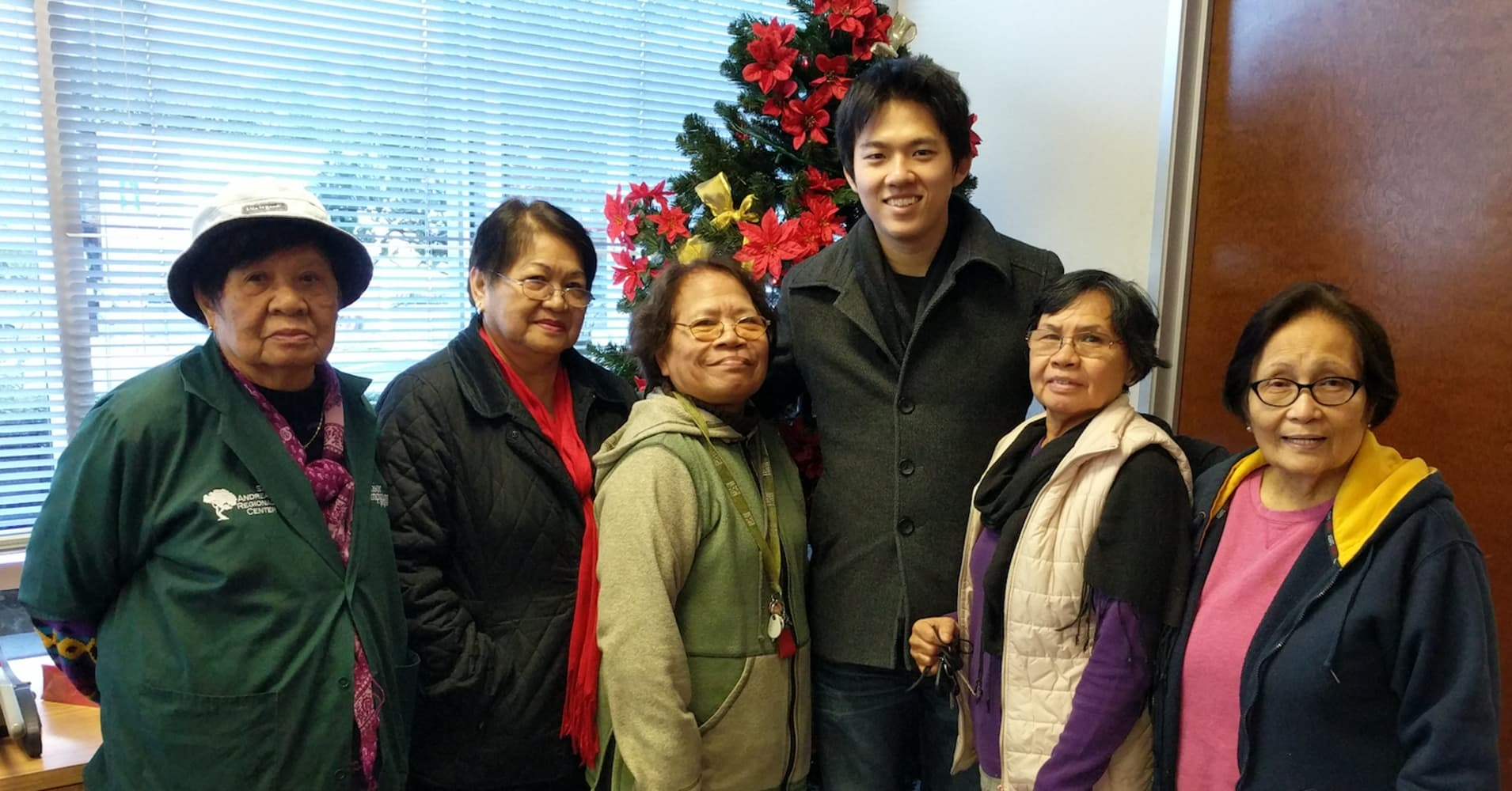 "Roger Jin with elderly volunteers at the warehouse, who he called the Grandmas, ""because they're kind and nurturing."""