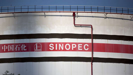 China Petroleum & Chemical Corp. (Sinopec) signage is displayed on one of the company's storage tanks in the Tsing Yi area of Hong Kong, China, on Monday, Aug. 26, 2013.