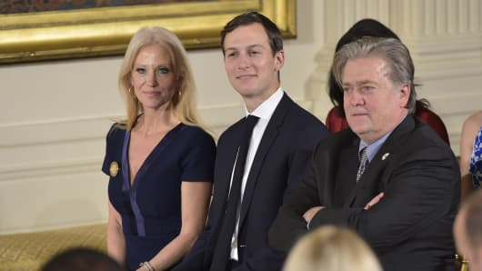 Counselor to the President Kellyanne Conway, Senior Advisor Jared Kushner and Chief Strategist Steve Bannon attend the White House senior staff swearing in at the White House on January 22, 2017, in Washington, DC.