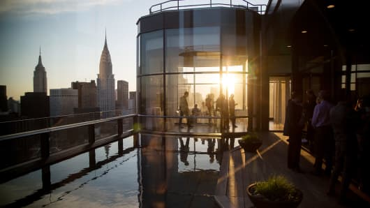 Guests attend a pool party in the penthouse apartment at the 50 United Nations Plaza building in New York. About 3,574 newly built apartments will reach the market in 2016, according to brokerage Corcoran Sunshine Marketing Group.