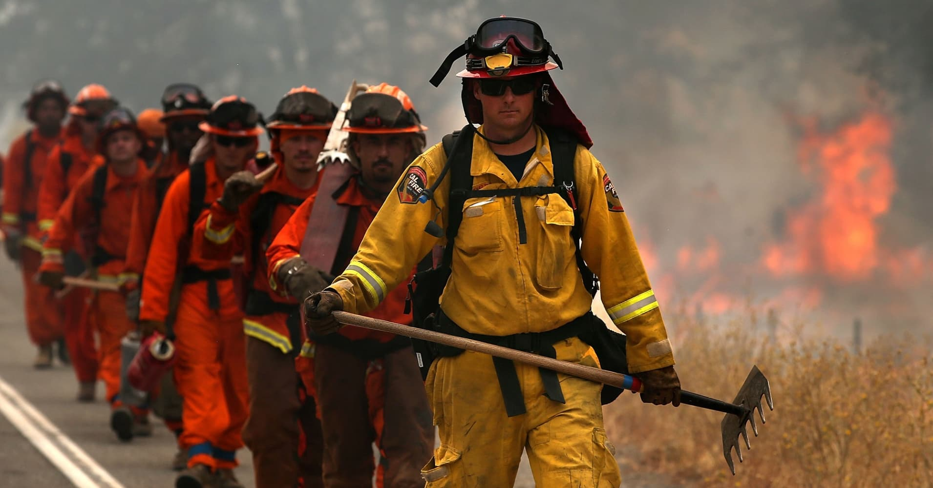 A Cal Fire firefighter leads a group of firefighters during a burn operation.