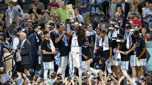Theo Pinson #1 of the North Carolina Tar Heels hoists the championship trophy with teammates during the 2017 NCAA Men's Final Four National Championship game against the Gonzaga Bulldogs at University of Phoenix Stadium on April 3, 2017 in Glendale, Arizona.