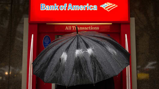 A pedestrian stops to use a Bank of America Corp. automated teller machine (ATM) in San Francisco, California.