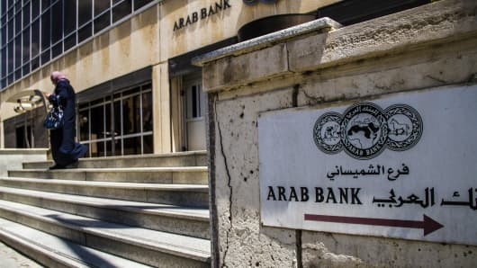 A sign sits on display outside the headquarters of Arab Bank PLC in the financial district in Amman, Jordan.