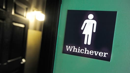 A gender neutral sign is posted outside a bathrooms at Oval Park Grill on May 11, 2016 in Durham, North Carolina. Debate over transgender bathroom access spreads nationwide as the U.S. Department of Justice countersues North Carolina Governor Pat McCrory from enforcing the provisions of House Bill 2 (HB2) that dictate what bathrooms transgender individuals can use.