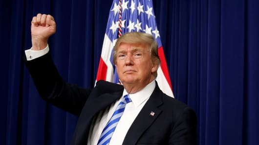 President Donald Trump pumps his fist as he departs after attending a CEO town hall on the American business climate at the Eisenhower Executive Office Building in Washington, U.S., April 4, 2017.