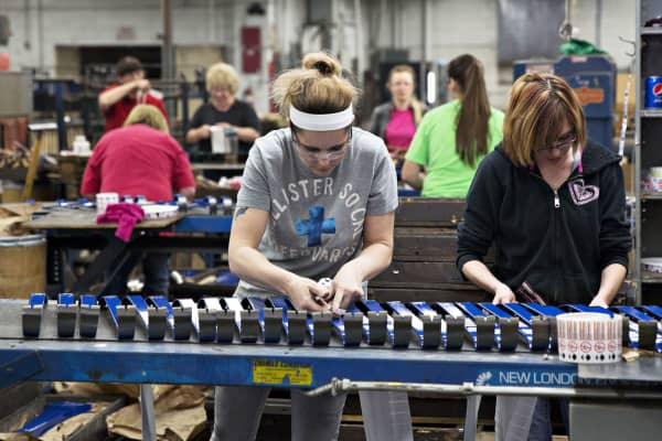 Employees place labels on prybars at the Vaughan & Bushnell Manufacturing Co. facility in Bushnell, Illinois.