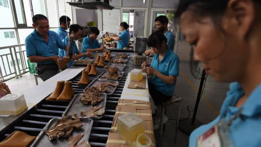 workers on a production line at the Huajian shoe factory, where about 100,000 pairs of Ivanka Trump-branded shoes have been made over the years amongst other brands, in Dongguan, in south China's Guangdong province.