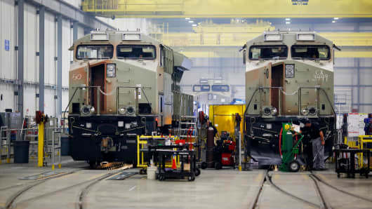 General Electric Evolution Series Tier 4 diesel locomotives stand on the final assembly line at the GE Manufacturing Solutions facility in Fort Worth, Texas, Oct. 25, 2016.