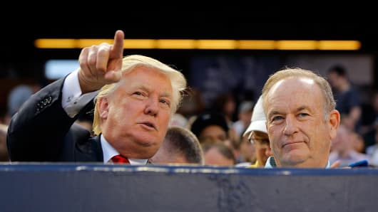Donald Trump (L) and television personality Bill O'Reilly.