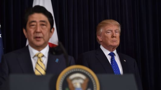Japanese Prime Minister Shinzo Abe (L) and US President Donald Trump speak at Trump's Mar-a-Lago resort in Palm Beach, Florida, on February 11, 2017.