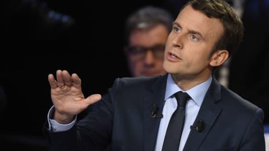 French presidential election candidate for the En Marche ! movement Emmanuel Macron gestures as he speaks during a debate on April 4, 2017.