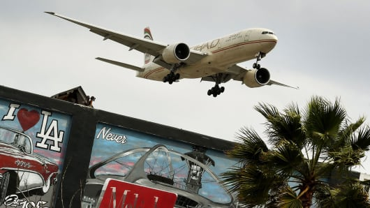 An Etihad Airlines plane from Abu Dhabi prepares to land at Los Angeles International Airport.